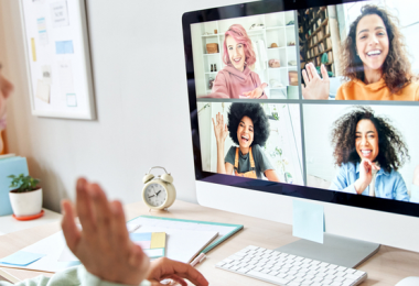 photo of a young woman in a video call with other young women