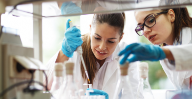 an image showing two women scientists working in a lab