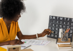 A young black woman organizing her freelancer calendar